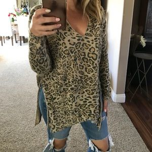 RDI leopard print slit side sweater. Tie in a knot